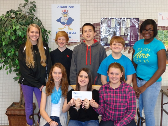 "Shown above are the SCA Officers and Representatives at Liberty Middle School who organized and conducted the ""Kiss the Pig"" fundraising event."