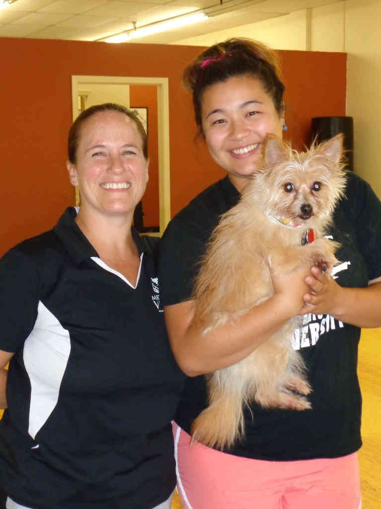 "Instructor Susan (left) and Instructor Mia (right) holding ""Chip"""